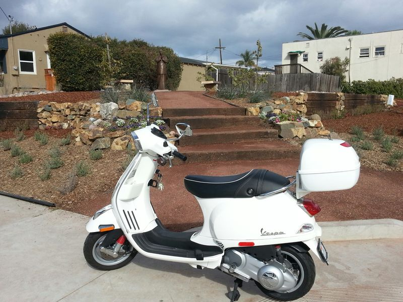 sri and vespa.jpg