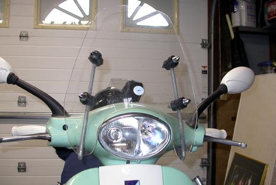 modern vespa : small windshield for lx150, is it worth it?