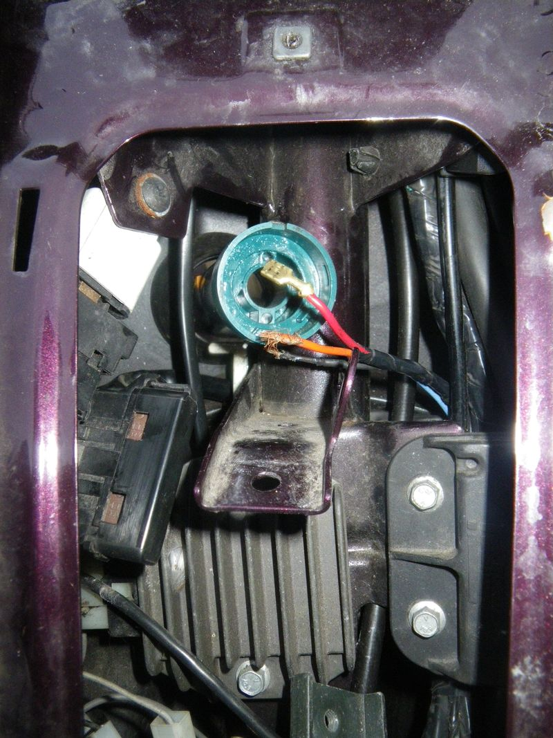 this is a photo through the horn shield with the fuse box and horn removed