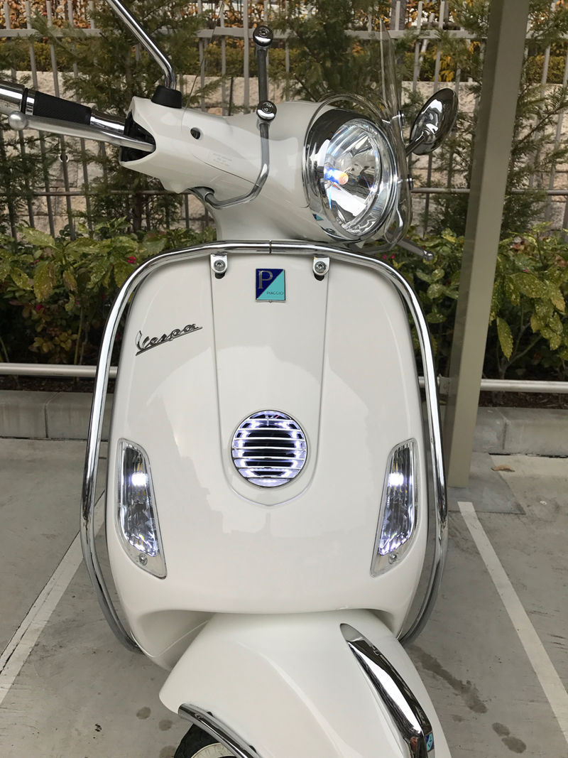 Vespa LX150ie LED horn cover.jpg